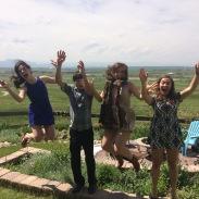 Jumping for joy in celebration of Garrett's graduation
